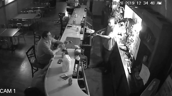 viral/news man sips beer during armed robbery in bar video goes viral
